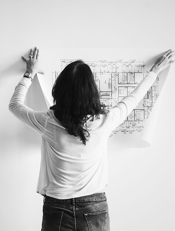 Interior designer hanging up blueprints